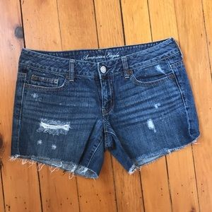 AEO Low Rise Distressed Frayed Jean Shorts